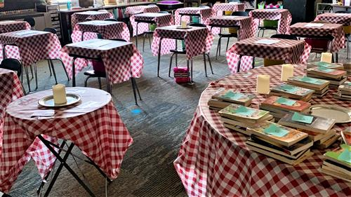 desks with checked tablecloths on them