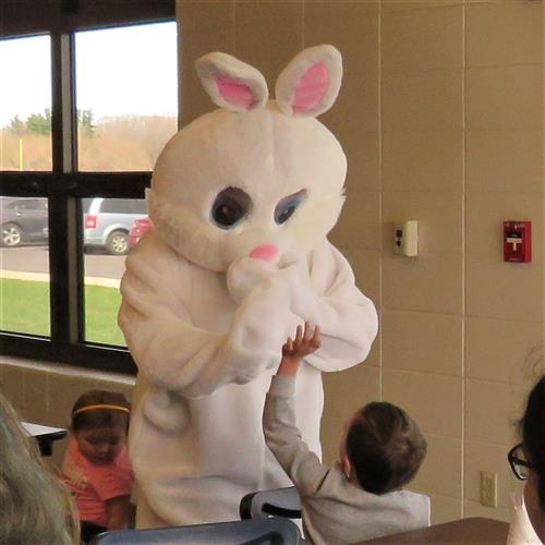 Easter bunny giving high fives