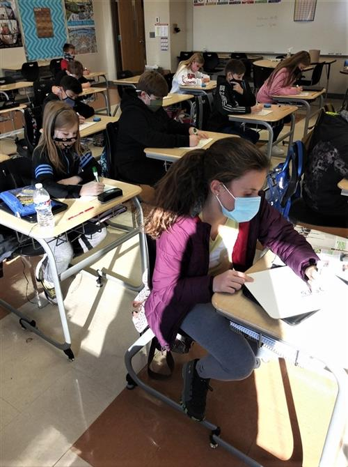 students at their desks working