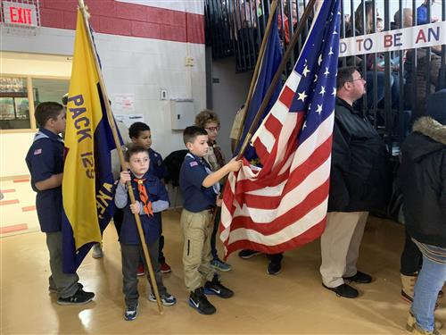 BOYS HOLDING FLAGS