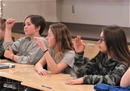 students using sign language