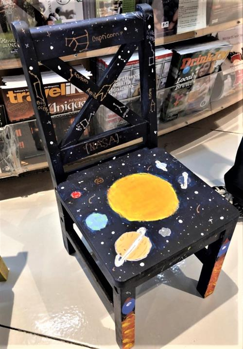 chair with planets and stars on it