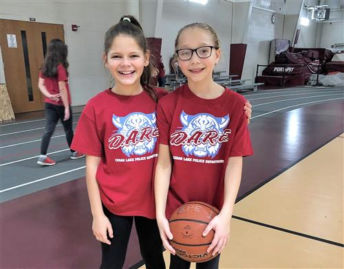 two girls with basketball