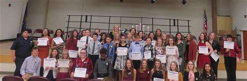 41 students holding certificates