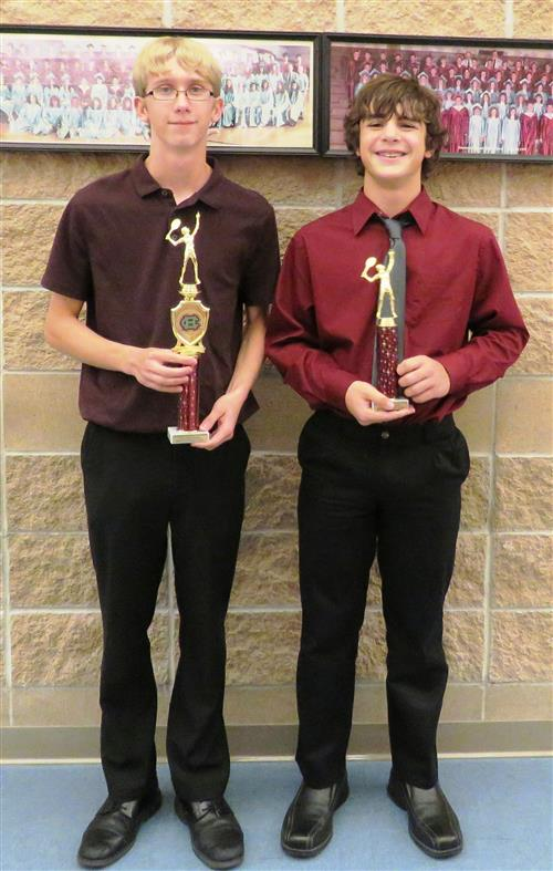 Picture of two boys tennis players with trophies