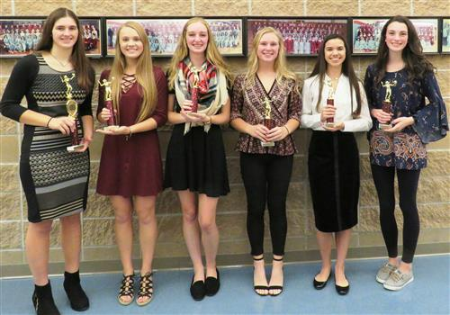Picture of six  girl volleyball players with trophies