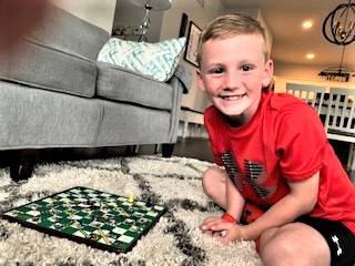 little boy with board game