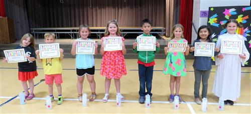 eight children with certificates