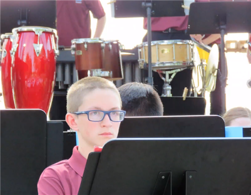 boy behind band stand