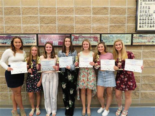7 girls with awards