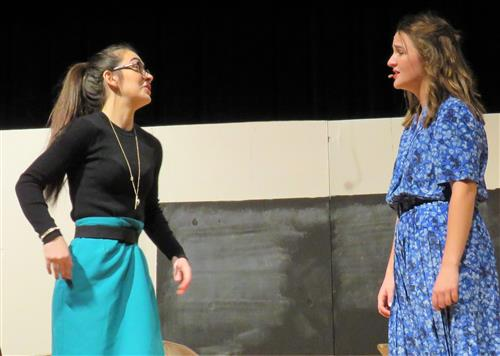 two girls arguing on stage