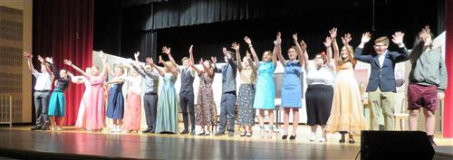 cast taking a bow