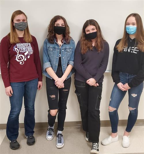 four girls with masks