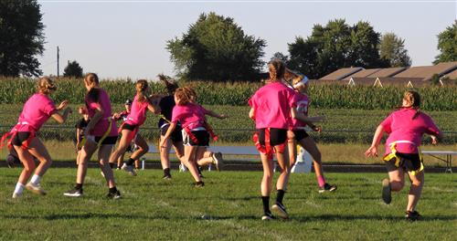 girls in pink playing flag football