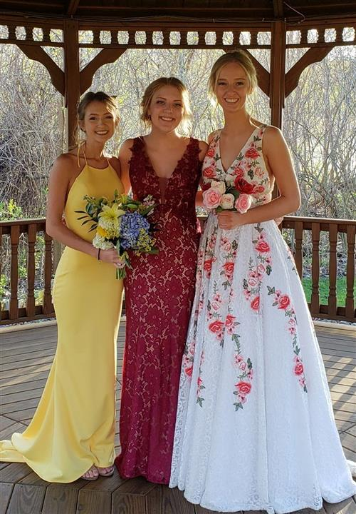 three girls in formal dresses