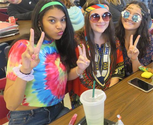 three girls dressed as hippies